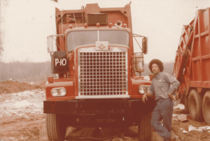 A Taylor with his rear load truck