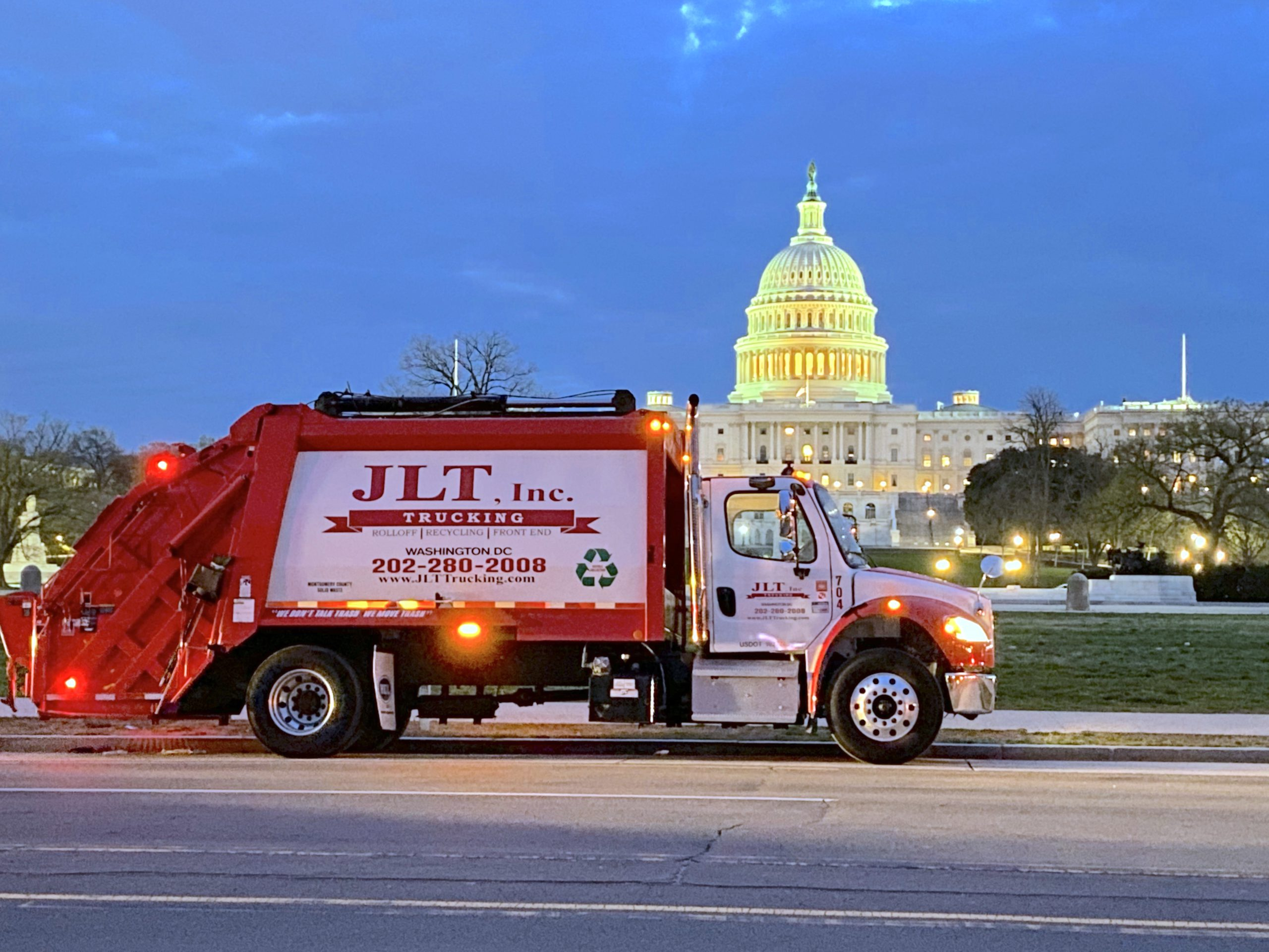 link for waste services; Rear load truck in front of the capital